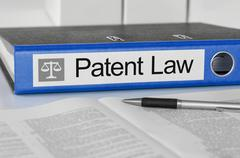Blue folder with the label Patent Law Stock Photos