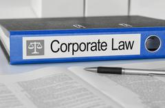 Blue folder with the label Corporate Law Stock Photos