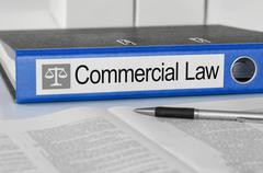 Blue folder with the label Commercial Law Stock Photos