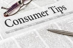 A newspaper with the headline Consumer Tips Stock Photos