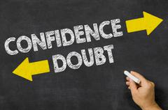 Confidence or Doubt written on a blackboard - stock photo