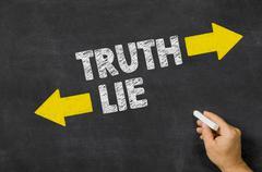 Truth or Lie written on a blackboard - stock photo