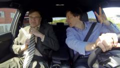 Two business men driving relaxed and friendly Stock Footage
