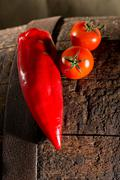 Two tomatoes and a capsicum Stock Photos