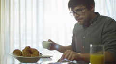 Man Have a Breakfast and Using Phone at Home Stock Footage