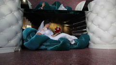 bride on sofa with bouquet of flowers - stock footage