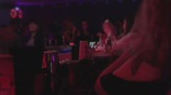People communicating at bar counter, prostitutes waiting clients Stock Footage
