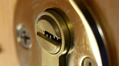 Key in door lock. - stock footage