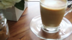 Hot cup of coffee on the wooden table feeling lonly on raining day Stock Footage
