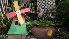 Small wood turbine on green garden Stock Footage