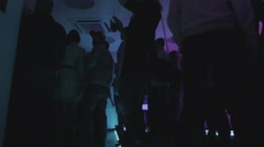 Guys communicating, hanging out, dancing, night club atmosphere Stock Footage