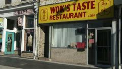 Establishing shot of Chinese restaurant in downtown Guelph Stock Footage