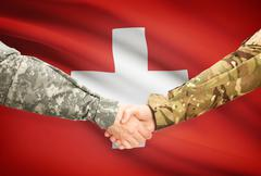 Stock Illustration of Soldiers shaking hands with flag on background - Switzerland