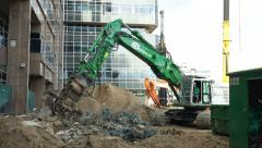 Large demolition machine eating concrete Stock Footage