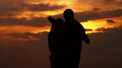 Silhouette of couple dancing on a beach - stock footage