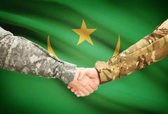 Stock Illustration of Soldiers shaking hands with flag on background - Mauritania