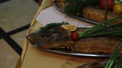 Fried pike decorated with verdure Stock Footage