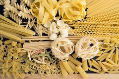 patern with rraw pasta on a wooden board, ready to be cooked - stock photo