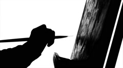 Painter`s hand continues drawing a painting by oil paints holding the palette in Stock Footage