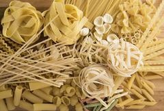 Patern with rraw pasta on a wooden board Stock Photos