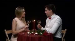 Romantic couple having dinner, clinking glasses. Close up Stock Footage