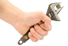 Hand holding monkey wrench Stock Photos