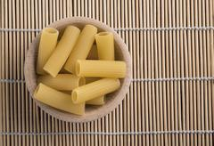 raw pasta called rigatoni - stock photo