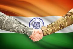 Stock Illustration of Soldiers shaking hands with flag on background - India