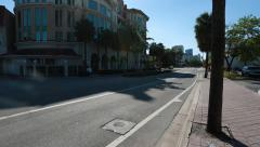 Establishing shot of Empty street.  Buildings and Trees Stock Footage