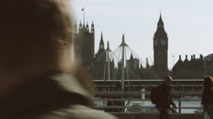 View on big ben London, London eye and commuters Stock Footage