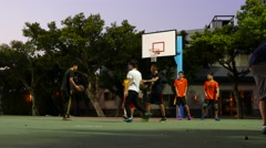 Friends playing basketball game on evening playground. Include sound Stock Footage