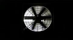 Exhaust fan on black wall, fan hole lit by the room lighting Stock Footage