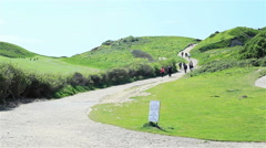 Tourists walking up the hill in Etretat, Normandy, France Stock Footage