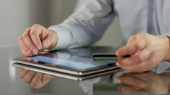 Male hands booking tickets, paying bill online on tablet PC Stock Footage