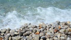 Sea waves rolling over the pebbled coast shore. Close up, 3 shots Stock Footage