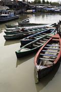 Boats in Jakarta slum Stock Photos