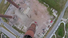 Aerial view looking straight down smokestack Stock Footage