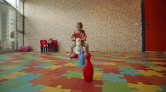 Cute little girl is 3.5 years old playing in the playroom - stock footage