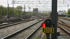 Stop light and departing train Stock Footage