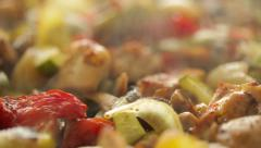 Freshly prepared pieces of chicken and vegetables baked in a pan. Dolly shot. Stock Footage