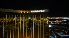 Las Vegas city lights reflecting on golden Mandalay Bay front Stock Footage