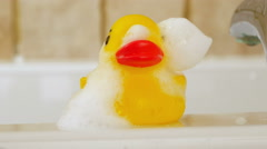 Shampoo running off rubber duck, 4k Stock Footage