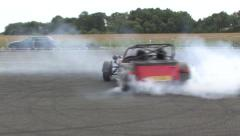 Red Caterham 7 drift Stock Footage