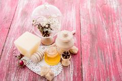 Spa treatment -  star anise, honey, salt, arranged with soap bar, pebbles and Stock Photos