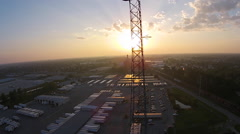 Sunrise seen through communications tower as camera ascends Stock Footage