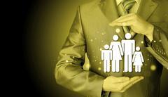 Businessman protecting family Insurance concept Stock Photos