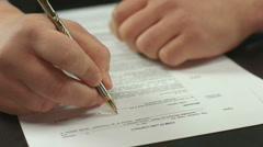 Closeup of male hand signing contract, businessman making deal Stock Footage