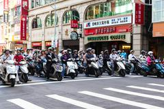 Scooter Riders During Morning Commute in Taipei, Taiwan Stock Photos
