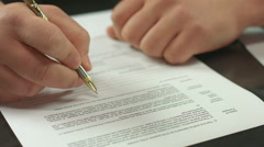 Male hand signing pages of contract, work with official document Stock Footage