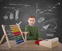 Child plays with money Stock Photos